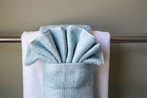 towel folding ideas for bathrooms how to hang bathroom towels decoratively with pictures ehow