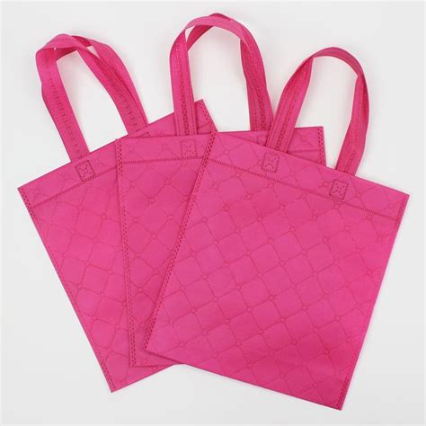 Goodie Bag Apparel 50pcs lot 32 25 8cm embossed non woven bag shopping bag gift bag clothing packing bags in