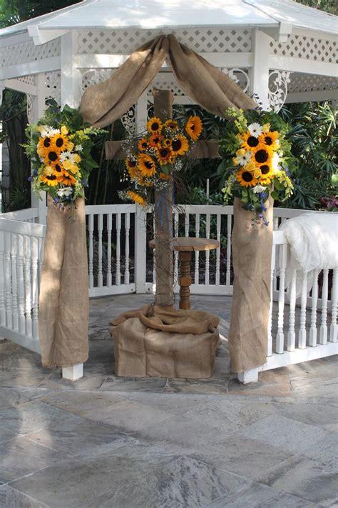 burlap sunflowers  gerberas decorate cross  gazebo
