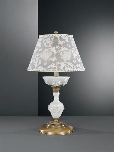 brass table l with white porcelain and l shade