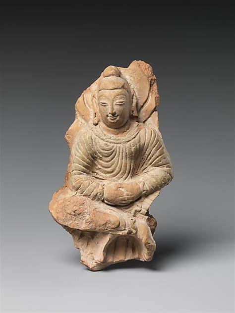 buddhist hair traditions seated buddha khotan kingdom period 6th 7th century china