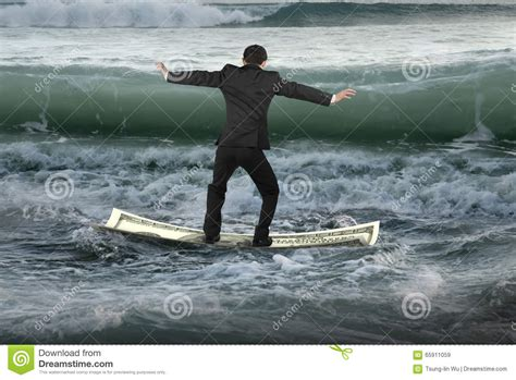 How To Float In Water While Standing by Businessman Balancing On Money Boat Floating In Ocean With