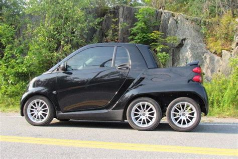 about smart cars someone built a 6 wheeled smart fortwo truck and it s awesome