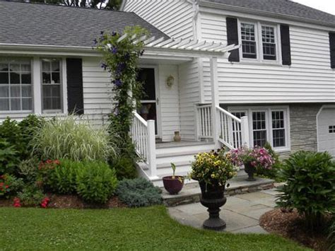 split level house with front porch image result for split level home front yard landscaping