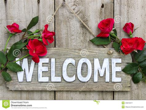 welcome images with flowers weathered welcome sign with red flowers hanging on old