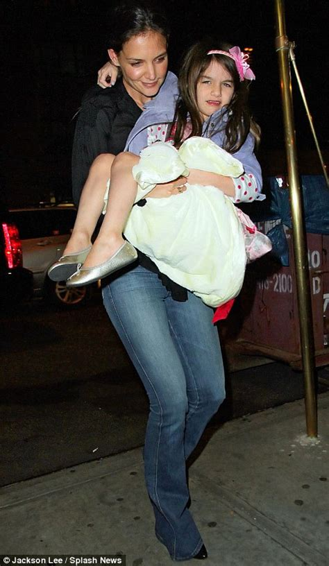 actress lifting and carrying actor katie holmes carries tired suri cruise off to bed after