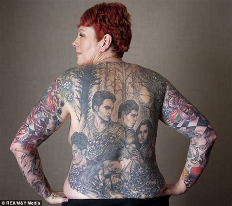 woman covered in tattoos covered in twilight tats literary ames