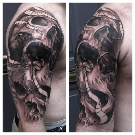 skull cover up tattoo cross coverup with skulls half sleeve