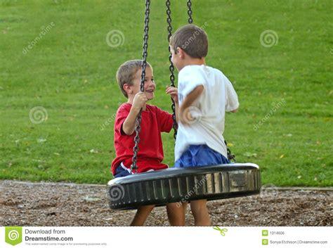 boy swing boys on tire swing royalty free stock image image 1314606