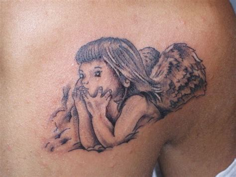 baby girl angel tattoo designs grey ink baby on collarbone