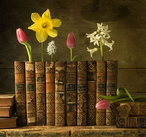 libri fiori books and flowers together content in a cottage
