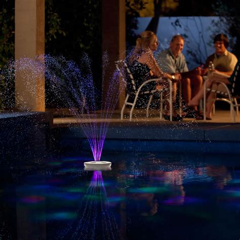 pool fountain with lights the floating lighted pool fountain hammacher schlemmer