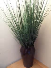 uk gardens large artificial green potted grass plant in a