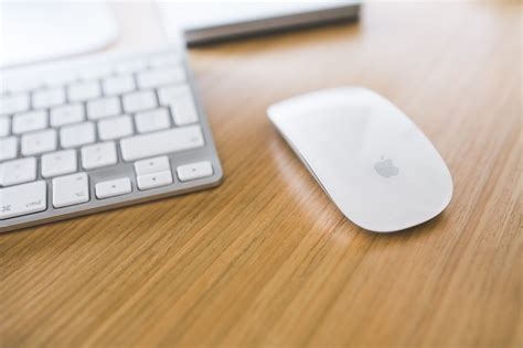 best mac mouse white apple mouse and keyboard on a wooden desk 183 free
