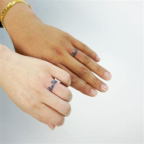 tattoo a ring on your finger 50 cool wedding ring tattoos to express their undying love