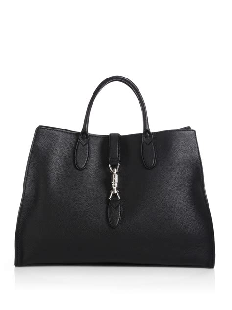 gucci jackie soft leather top handle bag in black lyst
