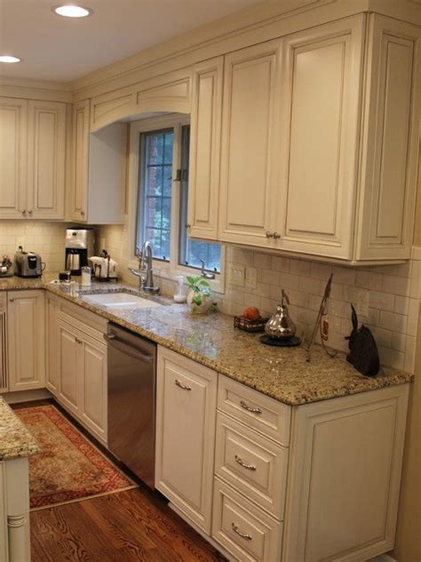 cream kitchen cabinets with glaze cream subway tile and distressed kitchen cabinets cream