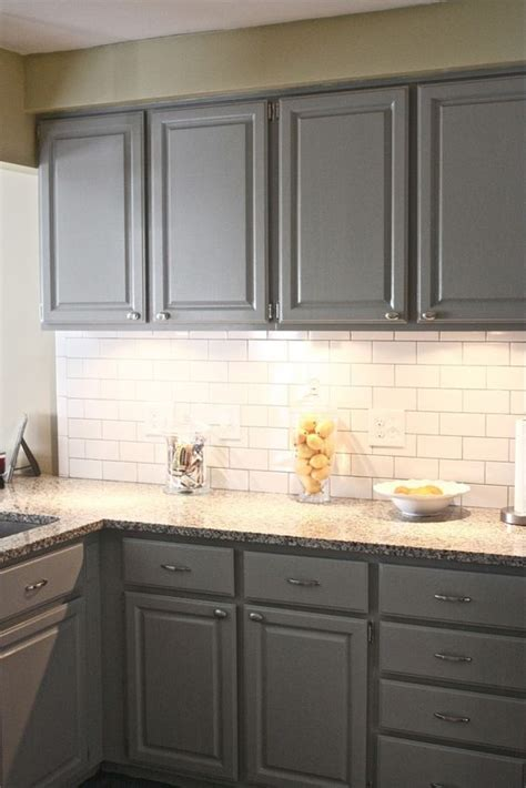 gray cabinets with white subway tile backsplash gray kitchen cabinet along with