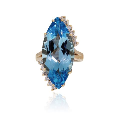 Blue Topaz For 14k yellow gold 50ctw blue topaz ring