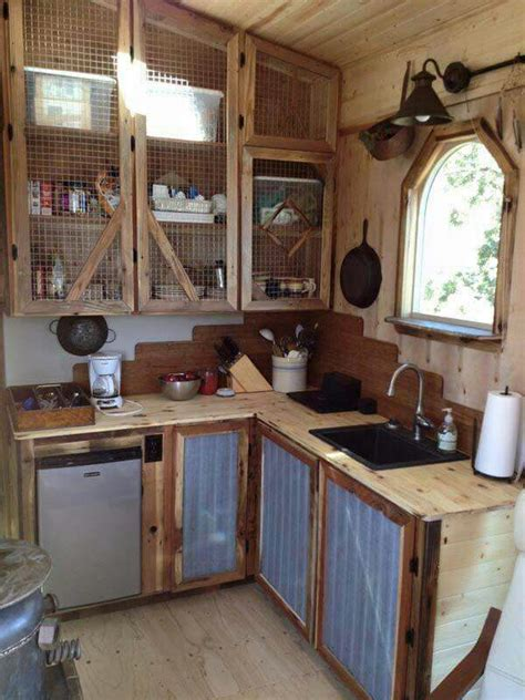 chicken wire kitchen cabinets chicken wire tin repurposed wood tiny houses