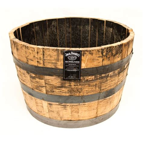 wooden whiskey barrel planters 25 in dia oak whiskey barrel planter b100 the home depot