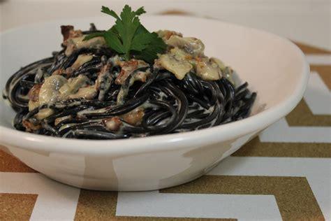 spaghetti al nero di seppia with alfredo sauce sprinkles and sauce