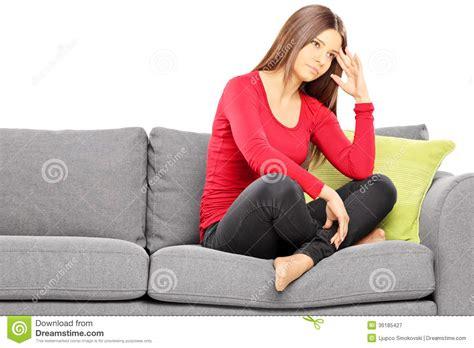 sofa sitting sad young woman sitting on a modern sofa royalty free