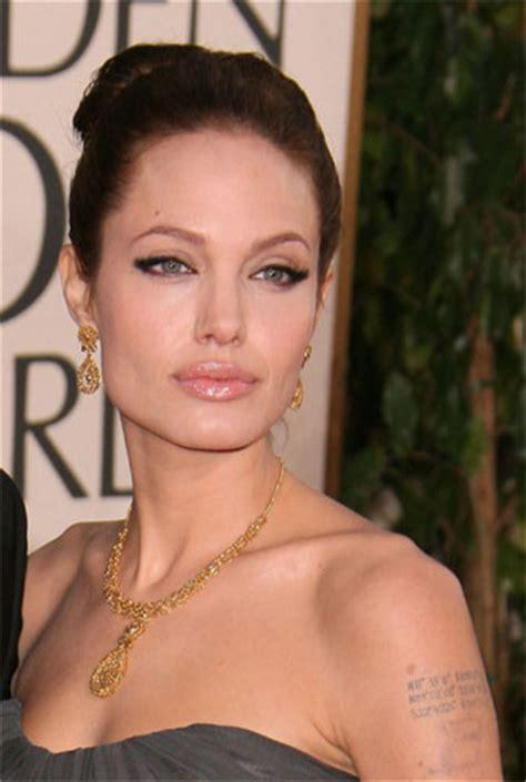 Angeline Glossy lip gloss golden globes