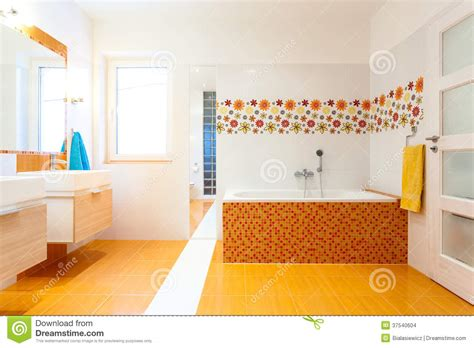 orange bathtub new contemporary bathroom with orange tiles stock images