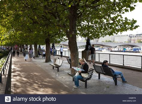 Sitting On The by Sitting On Benches The Shade Of Tree On The
