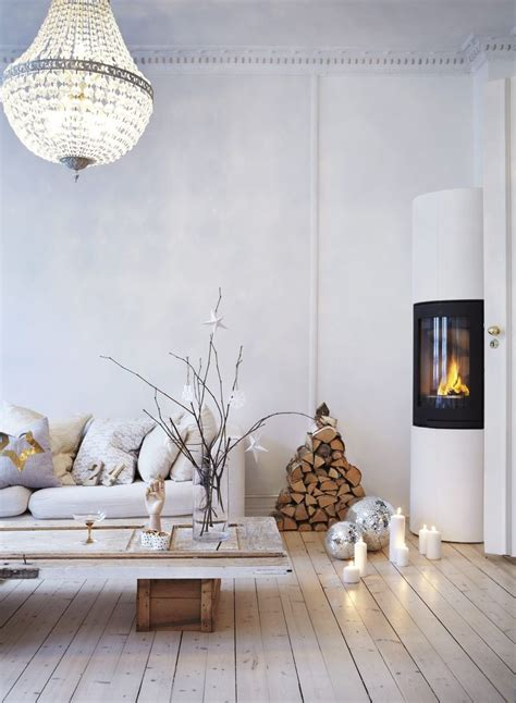 fireplace scandinavian icelandic beige white washed  weatehred hardwood floors diy door  coffee table christmas decor design shabby chic