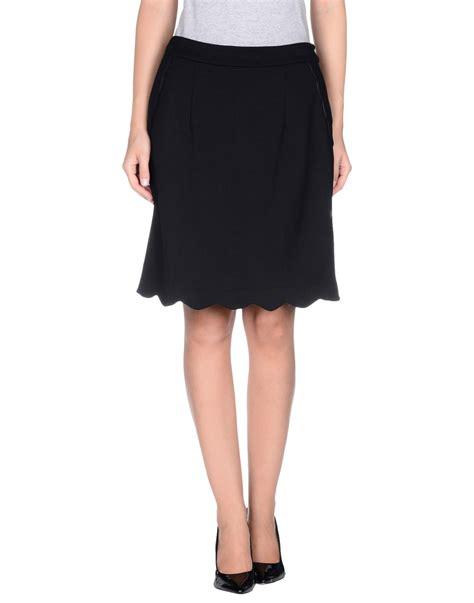 knee length skirt in black lyst