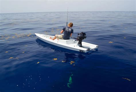 single person fishing boat the one man powered boat a fishing kayak skiff and sup