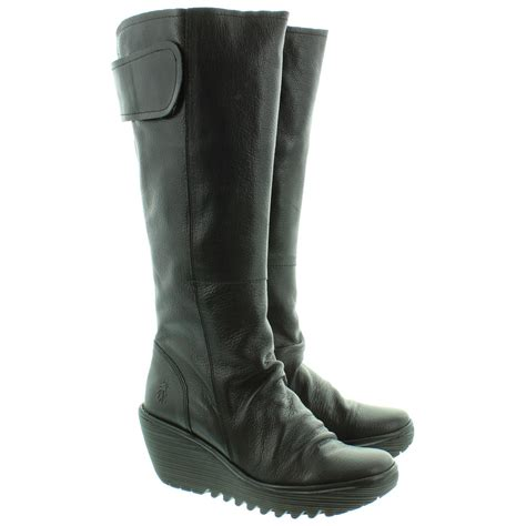 fly yulo knee boots in black in black