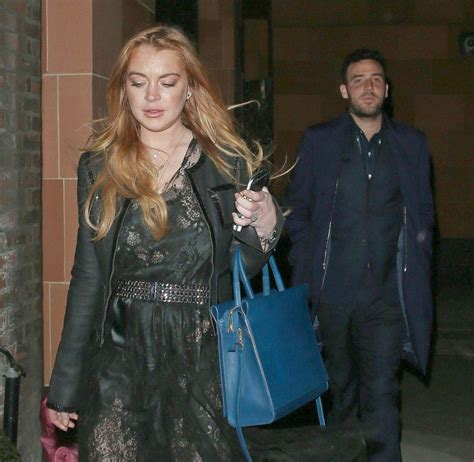 Lindsay Lohan Leaves Hospital Goes To Club by Lindsay Lohan Leaves A Club With A Mistery Celebzz