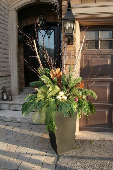 christmas decorating huge stone urns in front of entrance pin by bbb on winter containers decorations and