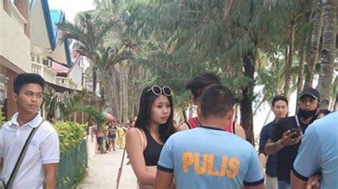 berpakaian terlalu seksi  pantai turis taiwan ditangkap