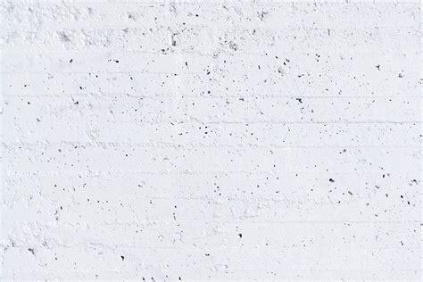 white concrete wall the white wall