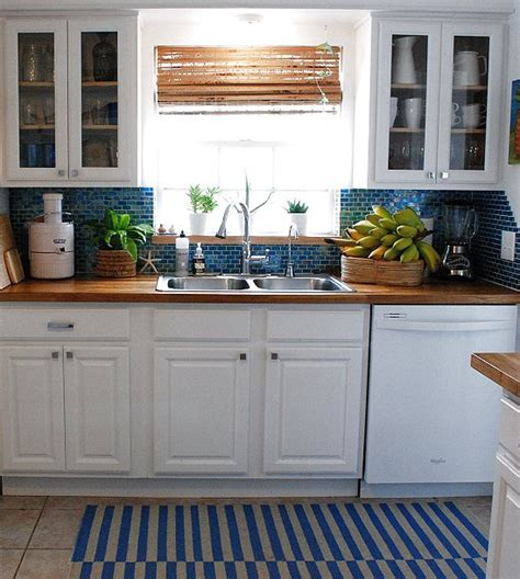 white kitchen cabinets with butcher block countertops white cabinets blue backsplash butcher block counters