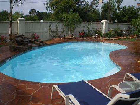 kidney shaped pools small kidney shaped fiberglass pool with beautiful decking