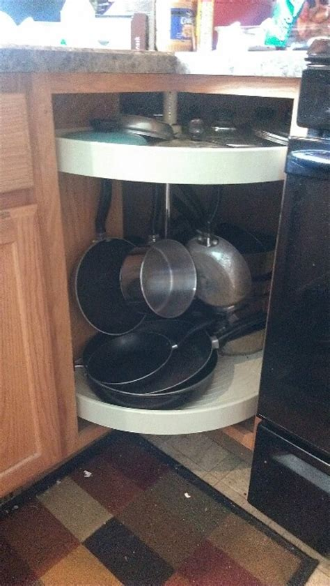 lazy susan corner kitchen cabinet pictures to pin on adjust your lazy susan for pot rack in corner cabinet and