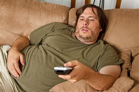 fat guy on couch tv watching lowers sperm count medical observer