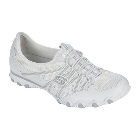 sketchers ticket white athletic shoe hit the in