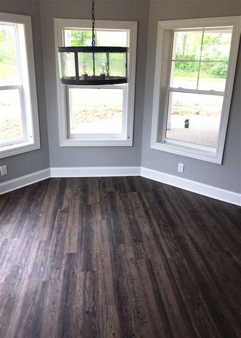 distressed luxury vinyl plank flooring  walkout basement