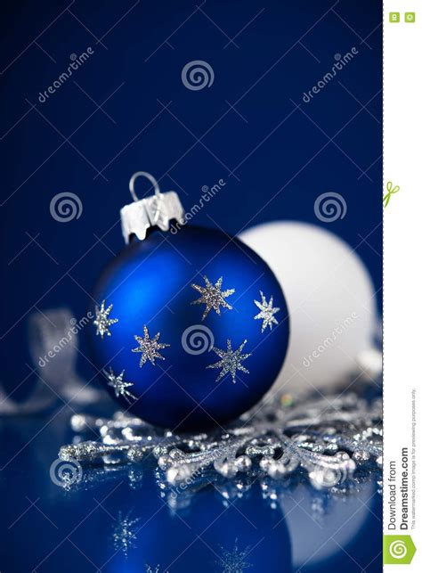 white blue ornaments silver white and blue ornaments on blue