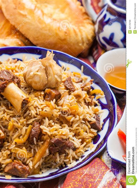 uzbek national food uzbek national food pilaf on traditional fabric adras