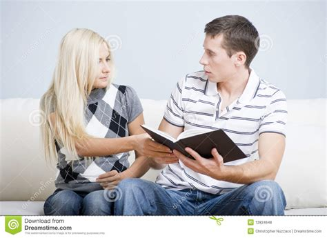 couple on couch couple on couch with book royalty free stock photos
