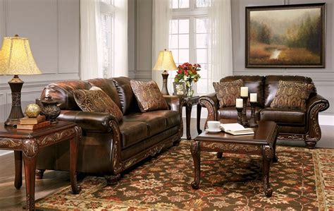 leather sofa set for living room vanceton brown leather traditional wood sofa loveseat