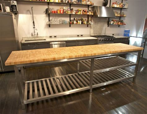chic stainless steel kitchen island with butcher block top
