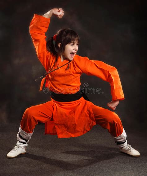 in an orange suit carries an expressive set of wushu stock image image 31048029